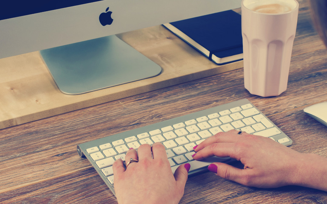 Woman typing on a bluetooth keyboard