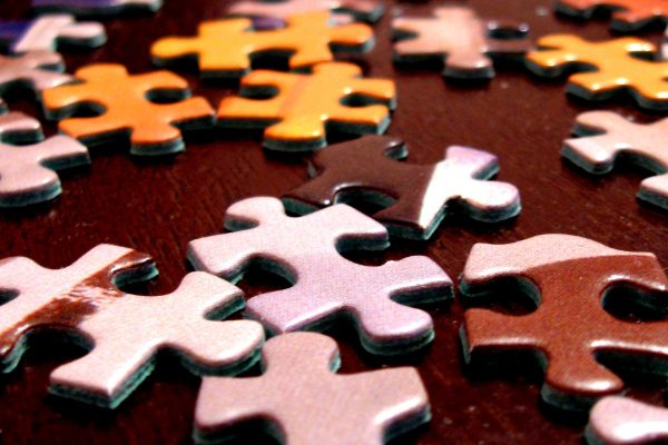 Scattered puzzle pieces on table